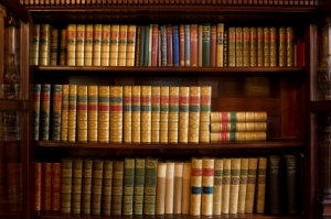 Bookshelf of antique books from about the 1920's and earlier.